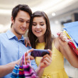 Happy young couple shopping — Stock Photo #25020079