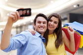 Happy young couple shopping — Stock Photo