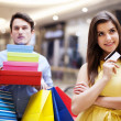 Portrait of a beautiful female shopaholic - Stock Photo