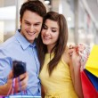 Bonding couple looking at mobile phone — Stockfoto #25241497