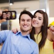 Happy couple taking a photo — Stock Photo #25241525