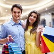 Happy couple after a successful shopping — Stock Photo