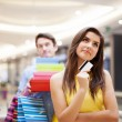 Portrait of a dreaming female shopaholic — Stock Photo #25415497