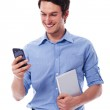 Smiling man using wireless devices — Stock Photo #25415695