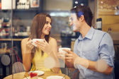 Two in cafe enjoying the time spending with each other — 图库照片