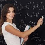 Female student thinking about mathematics problem — Stock Photo #25742205