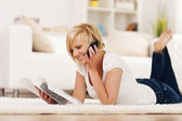 Happy woman ordering something from catalog — Stock Photo