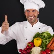 Chef with vegetables — Stock Photo #26564345