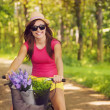 Beautiful woman have fun during cycling  — Foto Stock