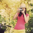 Retro photographer using old camera — Stock Photo #27343871