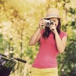 Retro photographer using old camera — Stock Photo #27343871