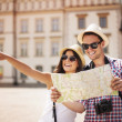 Happy tourist sightseeing city with map — Stock Photo