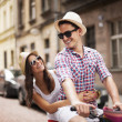 Handsome man taking his girlfriend on bicycle rack — Stock Photo