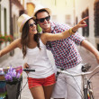 Happy couple with bikes in the city — Stock Photo
