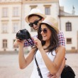 Cute couple looking on their photos on camera — Stock Photo #28076695