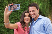 Happy couple making a photo of themselves — Stock Photo