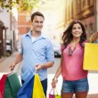 Young couple with shopping bag in the city — Stock Photo