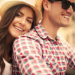 Close up of loving couple riding on bike in the city — Stock Photo #28680909