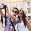 Happy tourists taking photo of themselves — Stock Photo