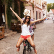 Happy young woman riding on bicycle with her boyfriend — Stock Photo
