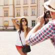 Man taking photo of his girlfriend — Stock Photo #28681151