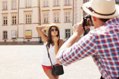 Man taking photo of his girlfriend — Stock Photo