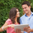 Young couple using digital tablet  — Foto de Stock