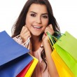 Happy woman with full of shopping bags — Стоковая фотография