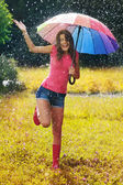 Young and beautiful woman have fun in rain — Stock Photo