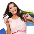 Happy woman holding shopping bag and credit card — Stock Photo