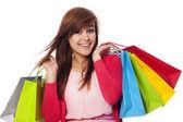 買い物袋を保持している女性の笑みを浮かべてください。 — ストック写真