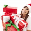 Woman with stack christmas gifts — Stock Photo