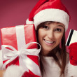 Santa woman with red gift box and credit card — Stock Photo