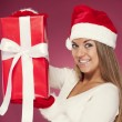 Woman showing red present — Stock Photo