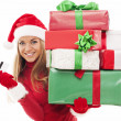 Woman holding christmas presents and credit card — Stock Photo