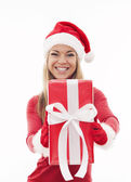 Woman holding red present — Stock Photo