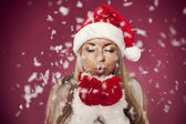 Blowing christmas snow — Stock Photo