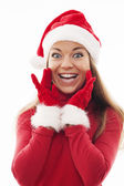 Woman with santa hat and gloves — Stock Photo
