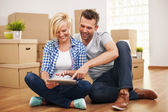 Couple buying new furniture for their home — ストック写真
