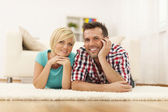 Portrait of loving couple on the floor in their house — Foto de Stock