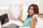 Woman and household bills — Stock Photo