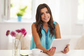 Smiling woman using digital tablet — Stock Photo