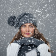 Beautiful young woman enjoys first snow — Stock Photo