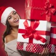 Cute young woman wearing santa hat — Stock Photo