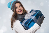 Beautiful woman with blue gift — Stock Photo
