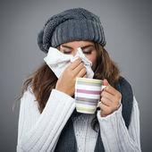 Jovem com gripe — Fotografia Stock