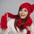 Young woman wearing red hat and scarf — Stock Photo