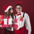 Loving couple with a lot of christmas gifts — Stock Photo