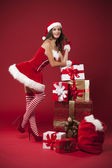 Sexy Mrs claus with christmas gifts — Stock Photo