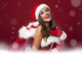 Magic time with sexy santa woman — Stock Photo